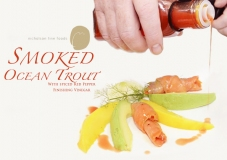 Smoked Ocean Trout with Red Pepper Finishing Vinegar pouring