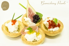 garnishing Pearls with goats cheese