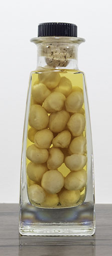 Macadamia nuts in macadamia truffle oil product image